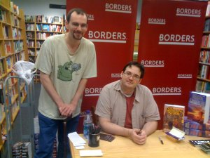 Pictured: a famous author, and a guy in a Schlock Mercenary shirt who now runs a blog called Novel Ninja. This was taken several years ago, on the book tour for The Way of Kings.