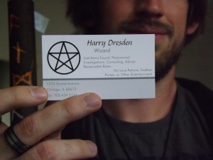A cosplayer at AwesomeCon, with Harry Dresden's actual business card as described in the books.